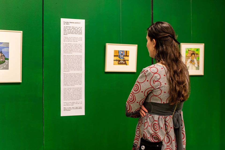Photo of a visitor of the exhibition during the opening. Photo by Nosh Neneh